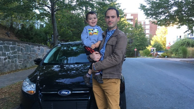 Jordan Bonaparte and his son, Dominic, in front of his 2013 Ford Focus. Bonaparte and his wife have stopped driving their son in the car because of safety concerns.