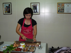 Photo: Oah preparing to teach us how to make the green curry paste (she's very cherry)