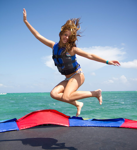 Have fun on a water trampoline (it's OK, it's your vacation!) on Grand Bahama Island.