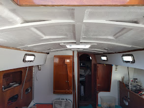 Photo: Overhead painted.  Side walls will receive one more coat of paint.