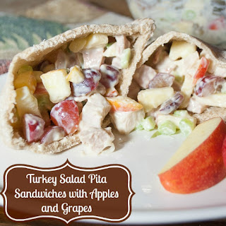 Pita Pocket Sandwiches Stuffed with Turkey, Apples and Grapes.
