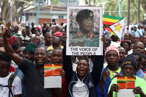 A protester holds up a poster of Zimbabwean armed forces commander Constantino Chiwenga, outside the parliament in Harare, Zimbabwe, on November 21, 2017. Picture: REUTERS
