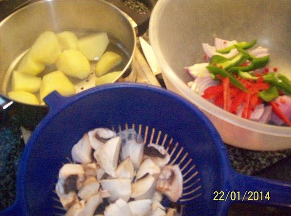 prepare all the vegetables , place the peeled and diced potatoes into a steamer...