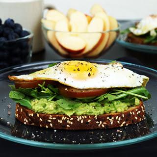 Avocado Arugula Sunny Side Up Egg Breakfast Toast.