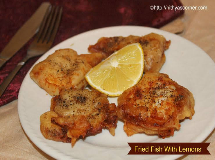 Fried fish with lemons