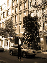"""Photo: """"99 Luft Black Balloons....or something like that...""""  Happy Halloween!   Lower East Side, New York City.  Sometimes there are moments that occur that are so whimsical and perfect for the time of year that it makes you stop dead in your tracks and smile the widest smile that you can accommodate. This was one of those moments.  I was walking around my neighborhood and a man was standing perfectly still with a gaggle of black balloons the day before Halloween. In typical New York City fashion, passerbys hardly even blinked an eye. They sort of resembled a very large bunch of grapes. I am sure they were for a Halloween event. At least I would like to imagine they were.  Happy Halloween everyone!   You can view this post if you wish at my site here:  http://nythroughthelens.com/post/12167490382/happy-halloween-balloons-lower-east-side-new    Tags: #halloween #nyc #newyork #lowereastside #photography #photo #happyhalloween #manhattan #balloons #festive"""
