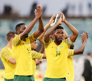 Thulani Hlatshwayo of South Africa and teammates thanking the fans during the 2019 African Cup Of Nations Qualifier match between South Africa and Libya at the Moses Mabhida Stadium, Durban on 08 September 2018.