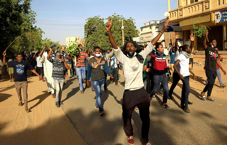 Sudanese demonstrators chant slogans as they march along the street during anti-government protests in Khartoum, Sudan. Picture: REUTERS/MOHAMED NURELDIN ABDALLAH