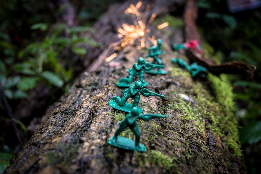 Battle, in the undergrowth by Martin J  Warren - Artistic Objects Toys ( green soldiers, plastic army men, toy army, plastic soldiers, kids, fire, war, smoke, photography, sparklers, army, macro, green army men, battle, army soldiers, toys, fireworks, surreal )