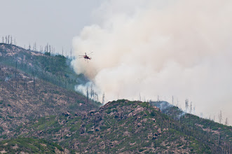 Photo: Helicopter leaves for another load of fire retardant.