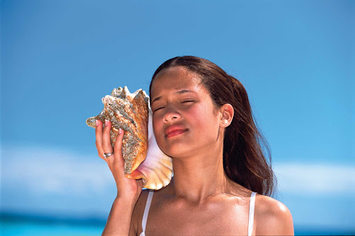 Dominican-Republic-conch-girl - Girl with a conch shell in the Dominican Republic.