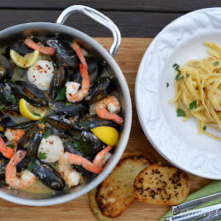 Steamed Mussels, Shrimp & Sea Scallops {over Linguine with Garlic Toast}.