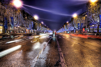 Photo: The Parisian boulevard where I should not have been standing  Paris is one of those places where the streets are always a little wet, at least in my head. If they are wet, then they are slippery and traffic will be crazy... so it sounded like a capital idea to go out into the middle of the Champs-Élysées to get a quick one!  from the blog at www.stuckincustoms.com