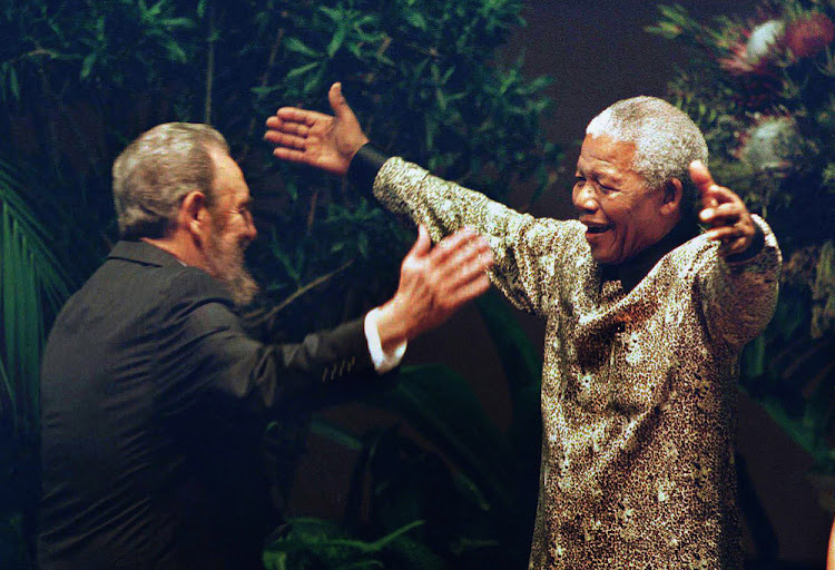 WARM WELCOME: Cuban leader Fidel Castro greets Nelson Mandela at the Non-Aligned Movement conference in Durban in 1998.  Picture: GETTY IMAGES