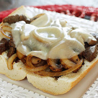 Steak and Cheese Sandwiches with Onions and Mushrooms.