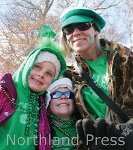 Photo: Anne, Sean Patrick and Kate McMullen of St. Paul enjoyed family fun in Crosslake on Saturday - photo by Paul Boblett
