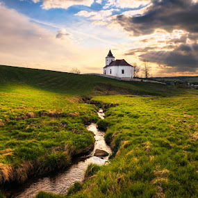 Under the dark clouds by Tomas Vocelka - Landscapes Prairies, Meadows & Fields ( clouds, ore mountains, stream, mountain, church, green, czech, travel, yellow, dramatic sky, mountains, krusne hory, sky, nature, blue, sunset, czech republic, meadow, dramatic, light, travel photography, #GARYFONGDRAMATICLIGHT, #WTFBOBDAVIS )