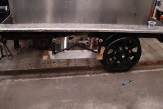 Photo: Left brake linkage restored and re-installed on the railcar. New (oak) brakepad test fitted on left-rear wheel. Aluminum fender/guard cleaned and reinstalled.