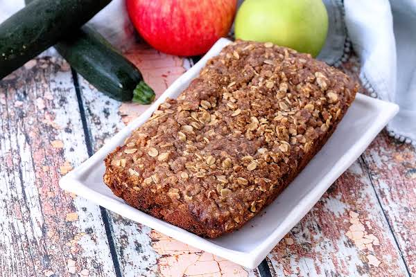 A Loaf Of Buttermilk Apple Pie Zucchini Bread On A Plate.