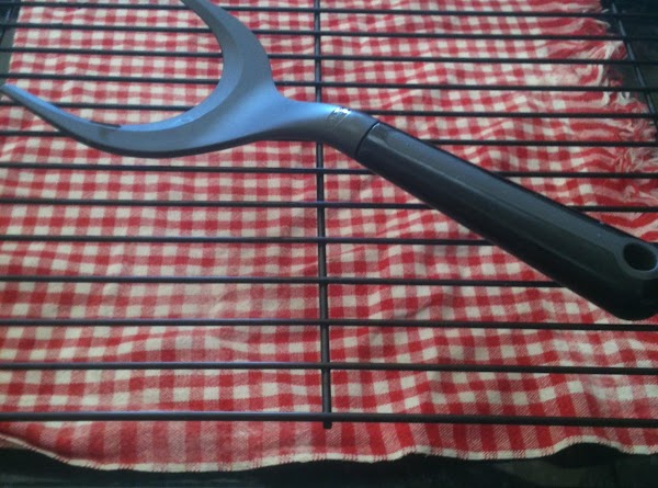 Using the pie lifter or fork, gently remove the pies onto a wire rack...