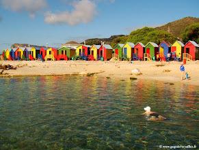 Photo: #016-La petite station balnéaire de Saint James avec ses cabines colorées.