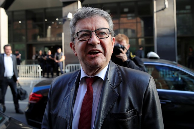Jean-Luc Melenchon, leader of far-left opposition France Insoumise (France Unbowed) political party, talks to journalists as he arrives at a police headquarters in Nanterre, near Paris, France, October 18, 2018.