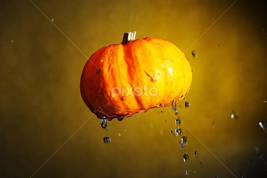Floating Pumpkin by Vineet Johri - Food & Drink Fruits & Vegetables ( water, pumpkin, drops, yellow, pwcvegetables,  )