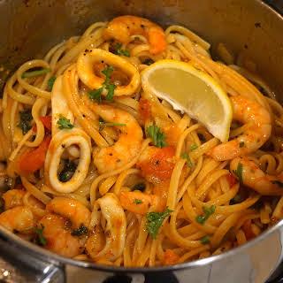 Quick dinner: Prawn and squid tomato spaghetti pasta recipe .
