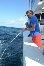 Photo: drew wrangling a red