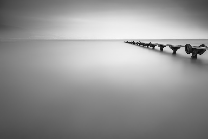 Photo: Abandoned(view large) From my blog: http://www.niophoto.com/abandoned/  In May this year, I was at Lac de Neuchâtel in Switzerland for a bit of long exposure shooting and shot an image called Tranquility. It was quite windy and foggy that day. Pretty nice conditions for this type of photography. Early this month I went back when weather conditions were comparable, to see if I could shoot more images with the same tranquil feeling to them. This image is one of the results.  Not everybody likes minimalistic black and white images like this. I however am appreciating them more and more. In addition they are fun to create and the actual shooting is quite relaxing. A welcome change from all the alpine landscape work I do ... a bit of relaxed lakeside shooting is a fantastic way to get rid of any muscle pains that result from long uphill hikes  To shoot this image I combined three Lee Neutral Density filters to decrease exposure with 15 stops. This gave me an exposure time of 2 minutes. I processed the image with Adobe's Lightroom 4 and Nik's Silver Efex Pro 2. Hope you like it!  #BWFineArtLE by +Joel Tjintjelaar, #MinimalMonday by +Olivier Du Tré,  #monochromeMonday +Monochrome Mondayby +Manuel Votta, +Nurcan Azaz, +Jerry Johnson and +Hans Berendsen, #BreakfastClub +Breakfast Clubby +Gemma Costa, #PlusPhotoExtract by +Jarek Klimek, +Landscape Photography #landscapephotography +BWLandscape #BWLandscape by +Margaret Tompkins, #10000photographersaroundtheworld +10000 PHOTOGRAPHERSby +Robert SKREINER+Walter Soestbergen+European Photo #EuropeanPhotography #hqsppromotion  #D800E  #bwfineart #bwphotography