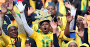 Mamelodi sundowns fans celebrate during the game against FC Barcelona.