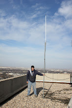 Photo: Garth holding the antenna for a test before mounting it