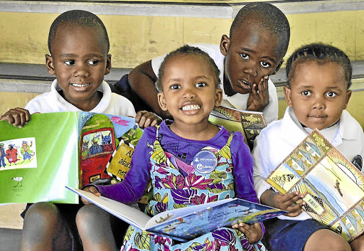 Early start: Preschoolers Sibabalwe, Lisakhanya, Linamandla and Sibusisiwe at the KwaMagxaki library in Port Elizabeth. Once at school, most children in SA do not receive mother tongue education. Picture: IVOR MARKMAN