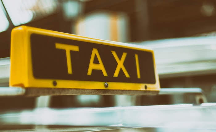 Taxi driver keeps licence despite motoring offences