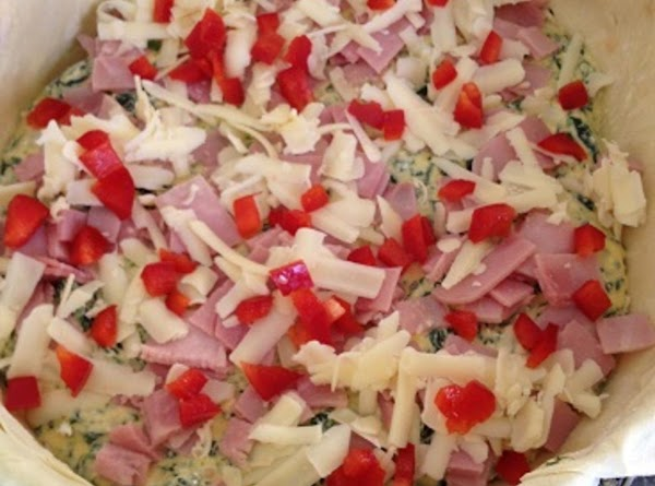 3. Now start layering all ingredients in pan. Ham, Cheese, Egg Mixture, Red pepper...