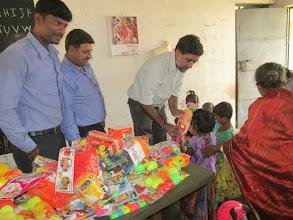 Photo: Kuppammal Chathiram Balwadi -- Rajaram giving toys to children.