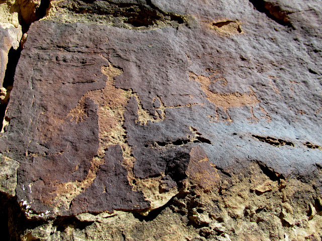 Detailed archer and bighorn sheep petroglyphs