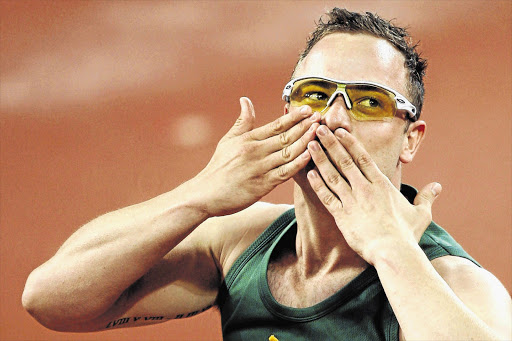BLOWING A KISS: Oscar Pistorius celebrates after winning the gold medal in the men's 400m T44 finals at the Beijing 2008 Paralympic Games