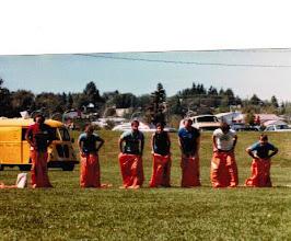 Photo: 1983 MTS Workshop, University of Alberta ( UQV), Edmonton, Alberta, Canada - Sack Race - (l to r) Charlie Benet, Don Porter, Jim Bodwin, Genie Wolfson, Gavin Eadie, Steve Peterson, Ray Davison