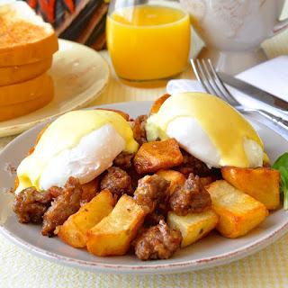 Italian Sausage Hash Eggs Benedict with Parmesan Hollandaise Sauce.