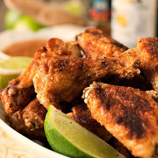 Crispy Asian Chicken Wings with Ginger-Lime Dipping Sauce.