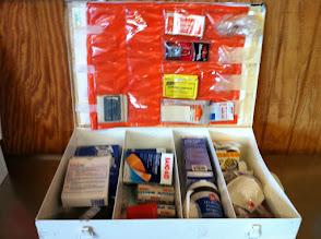 Photo: First aid box white metal, orange inside