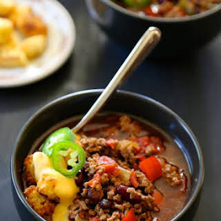 Slow Cooker Tijuana Chili with Jalapeno Cornbread Croutons & Queso.