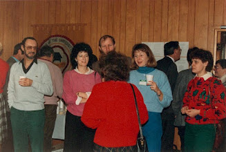 Photo: 1986. APLA-10. University of New Brunswick. Murray Kinloch Souvenir Album, 17  (left to right) Robert Papen (holding coffee cup), Ruth King, Walter Cichocki, Shana Poplack (in red pullover, back to camera), Alison Sollows-Astle, John Hewson (in profile against white background), Donna Atkinson  Photograph by Jean Kinloch, caption by Murray Kinloch