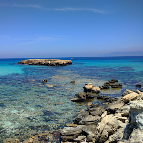 Blue Lagoon by Anastasis Agathokleous - Landscapes Waterscapes ( blue water, skylines, blue, rocks, island, beach, sun, sea, summer )