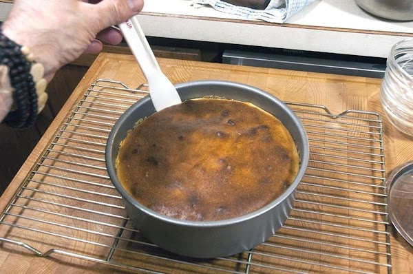 Run a knife around the edges of the cheesecake to separate it from the...