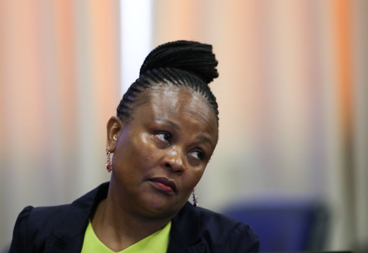 Busisiwe Mkhwebane's public battle with two former Sars officials shows no signs of ending.