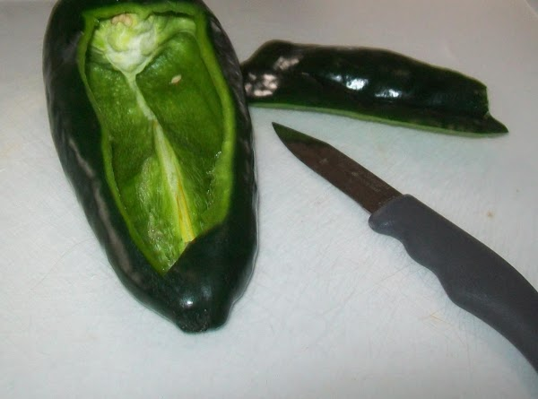 With a small paring knife make a pocket in each one of the peppers,...