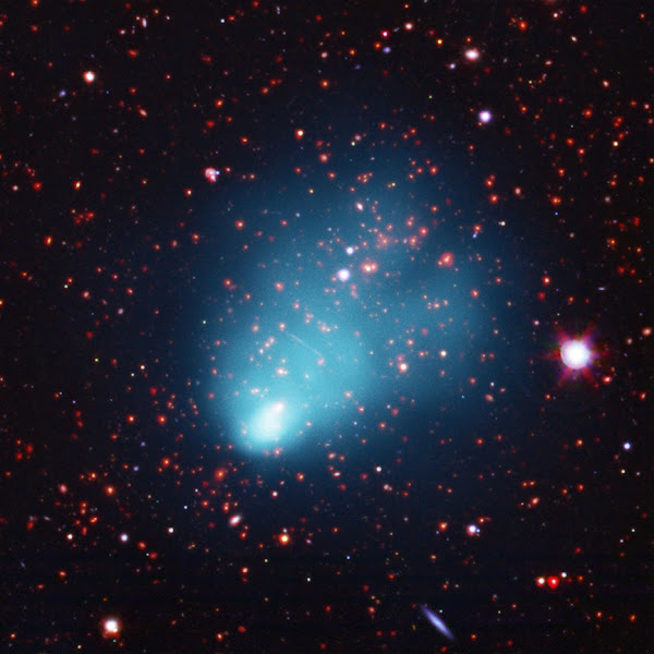 """Photo: El Gordo (ACT-CL J0102-4915): NASA's Chandra Finds Largest Galaxy Cluster in Early Universe http://chandra.harvard.edu/photo/2012/elgordo/  This galaxy cluster, which has been nicknamed """"El Gordo"""" for the """"big"""" or """"fat"""" one in Spanish, is a remarkable object. Found in the distant Universe by Chandra and the Atacama Cosmology Telescope, El Gordo appears to be the most massive, the hottest, and gives off the most X-rays of any known cluster at its distance or beyond. In this composite image of El Gordo, X-rays are blue, optical data from the Very Large Telescope are red, green, and blue, and infrared emission from Spitzer is red. The comet-like shape of the X-rays, along with optical data, show that El Gordo is actually the site of a collision between two galaxy clusters, similar to the well-known Bullet Cluster."""