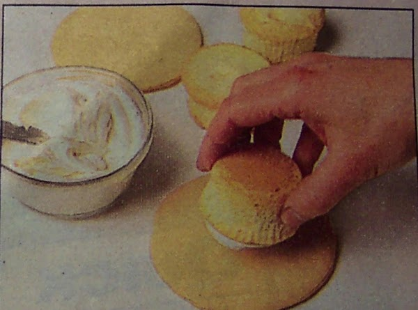 Remove cupcakes from liners.Trim tops to  to level tops. Spread top of 1...